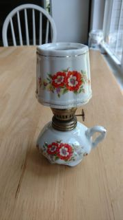 """Oil lamp with flowers measures 6"""""""
