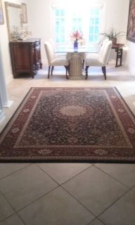 Blue and maroon Persian carpet