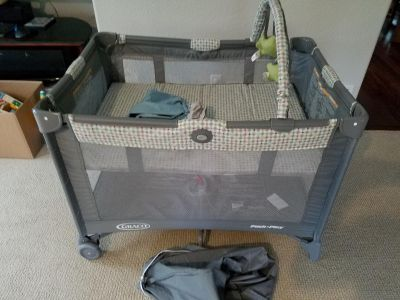 Nearly New Graco Pack and Play with bassinet and waterproof sheets
