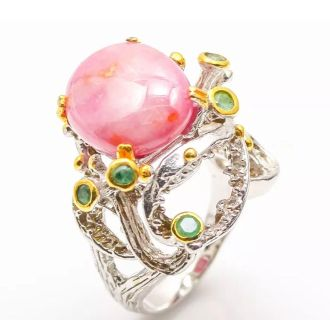 Very large raw Ruby with Emerald accent set in sterling and 14 carat gold