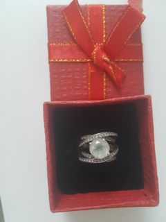 Sterling silver ring with white topez stone.