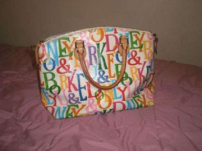 $125 Dooney and Bourke White Multi Color Purse (Sioux Falls, SD)