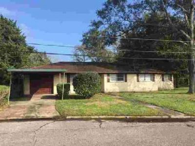 1818 7th Orange, Three BR and 1.5 BA brick home on a