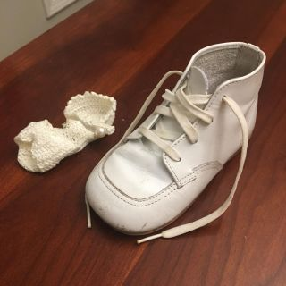 Buster Brown and tiny crocheted newborn slipper