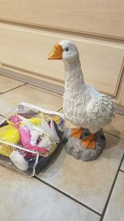 Goose statue that has an outfit for every month/holiday. $5