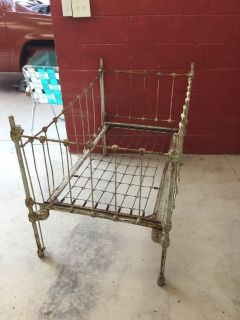 Old solid iron baby bed