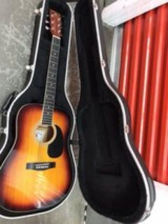 acoustic guitar with nice hard case