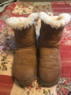 UGG boots with the bow ties at back.