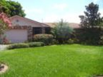 PET FRIENDLY...This spacious Four BR, Two BA home has a