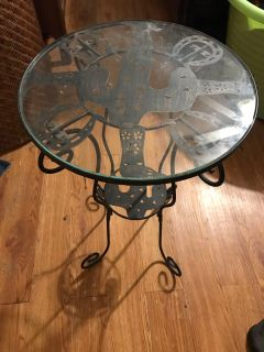 Super cute metal cactus and horseshoe table with glass top