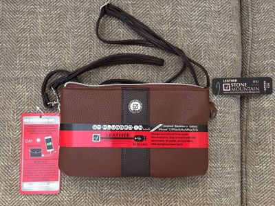 NWT Leather crossbody with USB charging power bank