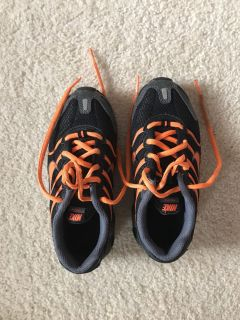 Size 13 child Nike s black and orange sneakers