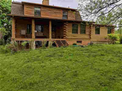 8909 Belcher Road Richmond Four BR, This log home is getting a