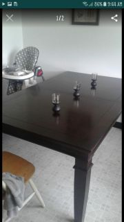 Cherry wood dining table with leaf