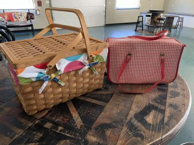 2 picnic baskets. Red & white one is a vintage carry all. Brazoria home pickup.