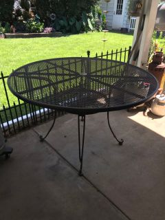 Round Black Outdoor Metal Table. The feet have their Pads but there is surface rust. Still Extremely Strong and Sturdy