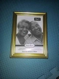 Gold plastic photo frame without glass