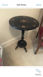 20.00 gorgeous side table/plant stand. It s black with gold accents and painted floral top. I ve had this for years. So pretty!