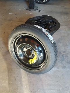 HYUNDAI VELOSTER SPARE TIRE KIT . THE WHOLE THING IS BRAND NEW , NEVER USED !