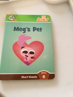 Meg s pet. This book uses several of the short E vowel sound.