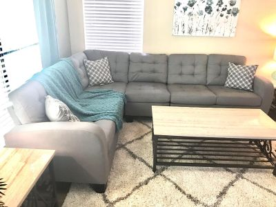 Tufted grey reversible sectional with accent pillows - new