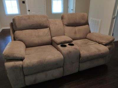 Reclining love seat with center console