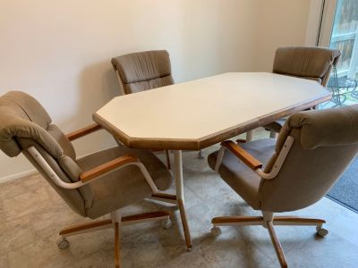 Kitchen Table and 4 Swivel/Rocking Chairs