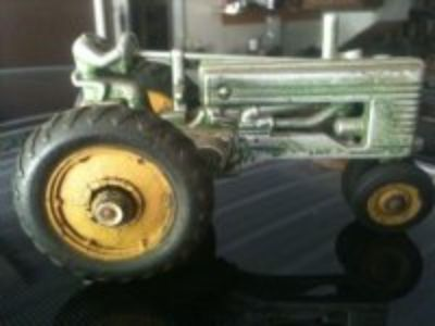 antique John Deere toy tractor made by Arcade