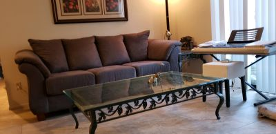 Glass and metal with grapevine design coffee table