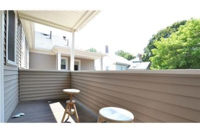Enjoy townhouse style living in this 3 bedroom 1 bath in Newton. 3+ Car Garage!