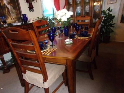 Table and chairs, Hutch, and two buffet