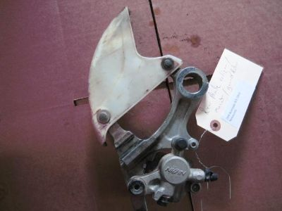 Find 2006 Kawasaki KX 250 F Rear Brake Caliper, mount and guard motorcycle in Shelbyville, Kentucky, US, for US $110.99