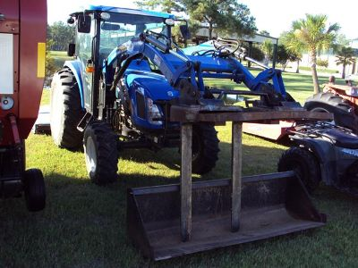 New Holland T2420  diesel  4x4  cab  air  heat  front end loader