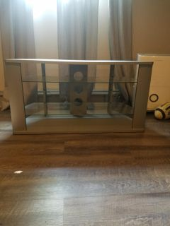 Gray three-tiered TV stand entertainment table