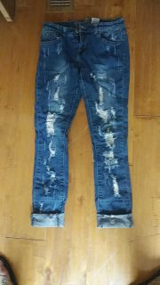 V.I.P. Jeans size 5/6 distressed look with the factory rip in them