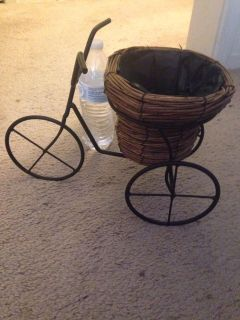 Metal bike for a little plant. $10 Firm