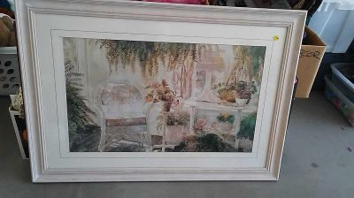 Large wood framed picture of wicker sunroom size 41 by 29 $10 excellent condition