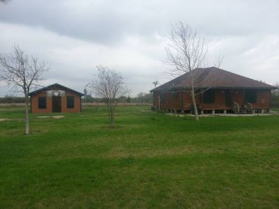 x0024210000 4 acres with log cabin n office ( 1825 west Rogers Edinburg)