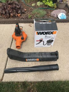 Work leaf mulcher and blower with trash cover