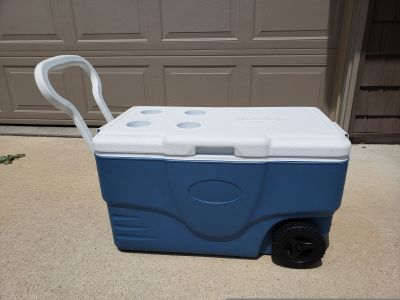 Coleman cooler with wheels. Maybe 58 qt, unsure.