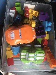 Mega blocks and cars in a container with lid