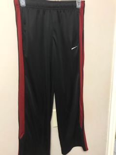 Nike boys size M red and black jogging pants