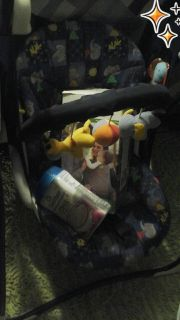 Baby swing with boba swaddle and Gerber oatmeal CEREAL