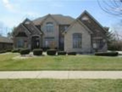 EXTRAORDINARY custom built all brick andamp; stone home in Lighthouse Pointe.**