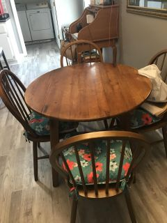 Drop leaf table new chairs cushions not for sale. We will meet.