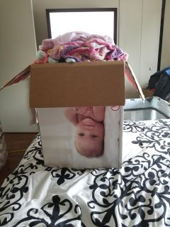 Hole box of baby girl clothes