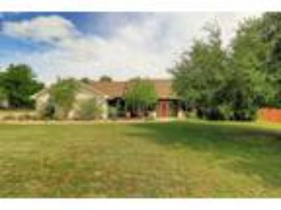 Beautiful Home on 1 acre in quiet gated neighborhood in acclaimed Liberty Hill