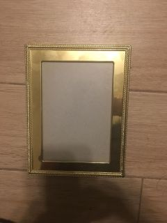 Gold Metal Picture Frame 5 by 7 very small scratch at the bottom left corner