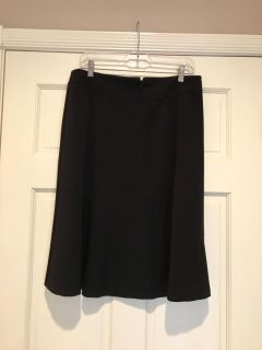 Black skirt, polyester, spandex and rayon blend. Excellent condition, rarely worn. Zipper in back.