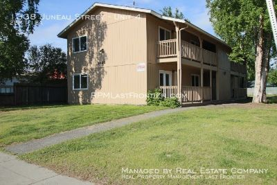 1/2 off 1st month-Second Story 2 Bedroom/1 Bath W/ Covered Patio Area